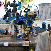 December 20, 2013 - Kiev, Ukraine: Pro-EU demonstrators listen to a activist speech in Independence Square.<br /> On the night of 21 November 2013, a wave of demonstrations and civil unrest began in Ukraine, when spontaneous protests erupted in the capital of Kiev as a response to the government's suspension of the preparations for signing an association and free trade agreement with the European Union. Anti-government protesters occupied Independence Square, also known as Maidan, demanding the resignation of President Viktor Yanukovych and accusing him of refusing the planned trade and political pact with the EU in favor of closer ties with Russia.<br /> After a days of demonstrations, an increasing number of people joined the protests. As a responses to a police crackdown on November 30, half a million people took the square. The protests are ongoing despite a heavy police presence in the city, regular sub-zero temperatures, and snow. (Paulo Nunes dos Santos/Polaris)