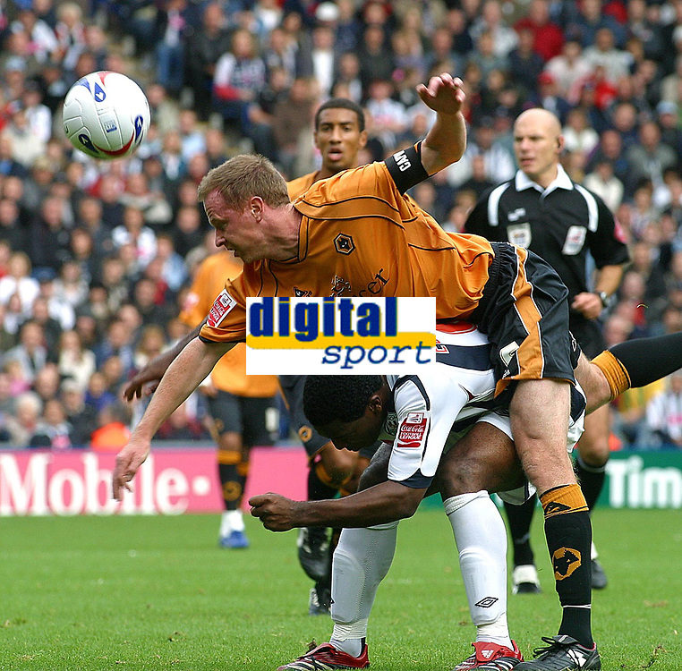 Photo: Dave Linney.<br />West Bromwich Albion v Wolverhampton Wanderers. Coca Cola Championship. 22/10/2006. Wolves Capt Jody Craddock (Top) gets a lift from  Nathan Ellington