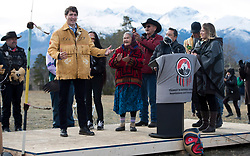 Prime Minister Justin Trudeau shows off a handmade jacket that was presented to him following a ceremony near Chilko Lake, B.C.,Friday, Nov. 2, 2018. The Prime Minister was in the area to apologize to the Tsilhqot'in community for the hangings of six chiefs during the so-called Chilcotin War over 150 years ago. Photo by The Canadian Press /Jonathan Hayward/ABACAPRESS.COM