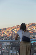 Woman looking at view with horizon and city, Valparaiso, Chile