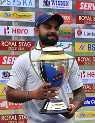 August 14, 2017 - Colombo, Sri Lanka - Indian cricket captain Virat Kohli poses with the winners trophy after the 3rd Day's play in the 3rd and final Test match between Sri Lanka and India at the Pallekele international cricket stadium at Kandy, Sri Lanka on MOnday 14 August 2017. (Credit Image: © Tharaka Basnayaka/NurPhoto via ZUMA Press)