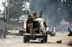 September 1, 2017 - Anan, Jammu And Kashmir, India - Massive clashes broke out between youth and government forces in south Kashmirs Anantnag district some 50 kilometers from summer capital of Indian controlled Kashmir on the eve of Id-ul-Azha. As soon as Eid prayers concluded at Hanfia Eidgah youth held protest demonstrations.They were chanting pro-Islam and pro freedom slogans.The protesters later clashed with police  and paramilitary forces deployed in strength outside.Youth hurled stones and bricks on the forces who lobbed tear shells,used sound shells,pepper and pellets. (Credit Image: © Aasif Shafi/Pacific Press via ZUMA Wire)