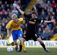 Photo. Glyn Thomas.<br /> Mansfield Town v Hull City.<br /> Nationwide League Division 3.<br /> Field Mill, Mansfield. 06/03/2004.<br /> Hull's Ian Ashby (R) denies fouling Mansfield's Craig Disley.