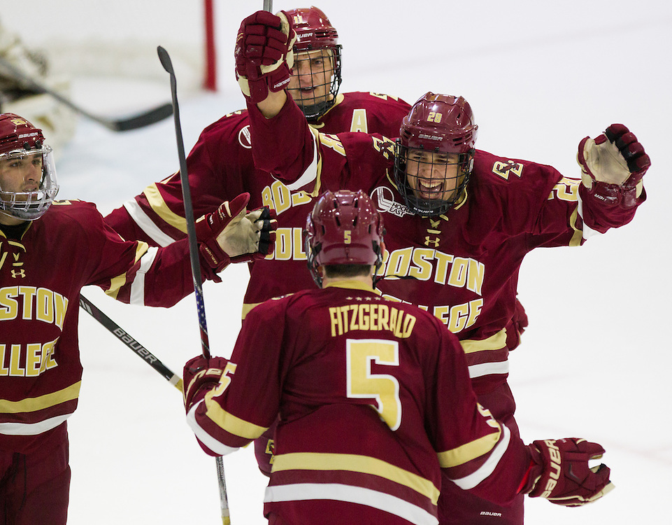 Boston College Forward Miles Wood (28) celebrates with Defenseman Casey Fitzgerald (5) after Fitzgerald scored a goal during the second period of a NCAA hockey game between Army and Boston College at Tate Rink on October 9, 2015 in West Point, New York. (Dustin Satloff)