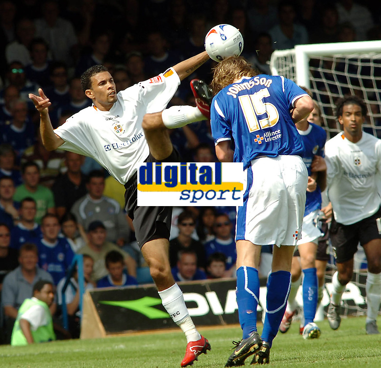 Photo: Kevin Poolman.<br />Luton Town v Leicester City. Coca Cola Championship.<br />05/08/2006. <br />Luton's Carlos Edwards (L) makes a high challenge on Leicester's Nil-Eric Johansson.