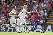 Christian Benteke of Crystal Palace breaks away while under pressure from Sam Clucas of Swansea City .<br /> Premier League match, Crystal Palace v Swansea city at Selhurst Park in London on Saturday 26th August 2017.<br /> pic by Kieran Clarke, Andrew Orchard sports photography.