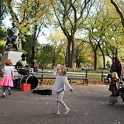 NEW YORK, NEW YORK - NOVEMBER 4: Children dance to a busker playing the drums in a fall scene in Central Park, Manhattan, New York.  4th November 2017. (Photo by Tim Clayton/Corbis via Getty Images)