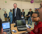 Qualcomm founder Irwin Jacobs talks with students during a tour the Energy Institue High School, March 24, 2016.