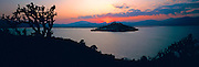 MEXICO, STATE OF MICHOACAN Island of Janitzio in Lake Patzcuaro with a colossal statue of Morelos on summit of island at sunset