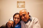 Proud father Gheorghe Budrega with his daughter Cornelia - a 22 years old Roma student in the house of her parents. She is is studying Commercial Business Administration in a Master Degree Program in Bucharest and never experienced any kind of discrimination because of being a Roma.