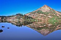 Reflections of Sugar Loaf Mountain in Lewis Lake of the Snowy Range.  Wyoming, USA.