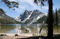 Towering granite peaks mirrored in alpine lakes reward hikers with spectacular views of Slide Lake in the Wind River Mountains