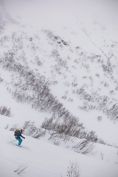 Young woman skiing off piste