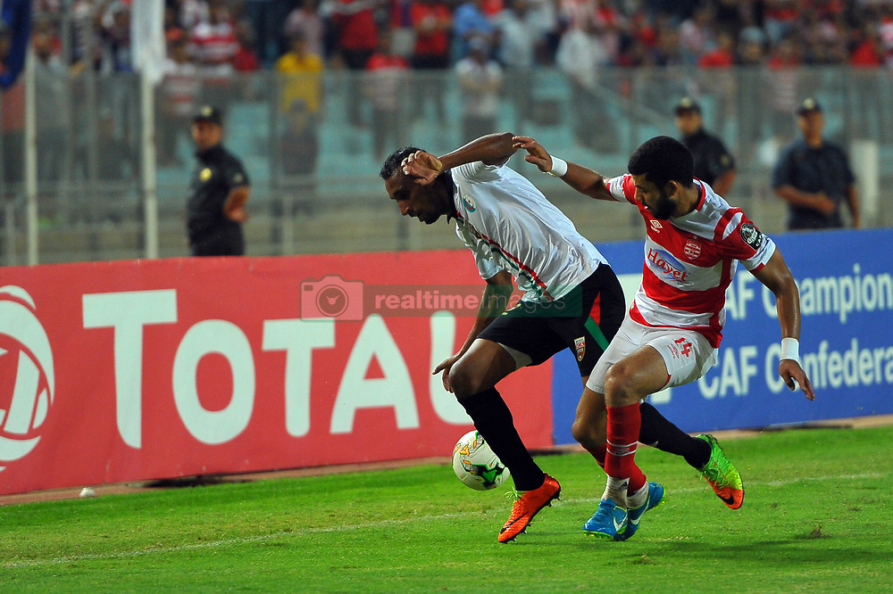 September 24, 2017 - Tunis, Tunisia - Ayoub Azzi(22) and Issam Dekhili(14)  during the quarter-final of the African Confederation Cup 2017 between Club Africain (Tunisia) and the Mouloudia Club of Algiers (Algeria) at the Olympic stadium in Rades. (Credit Image: © Chokri Mahjoub via ZUMA Wire)
