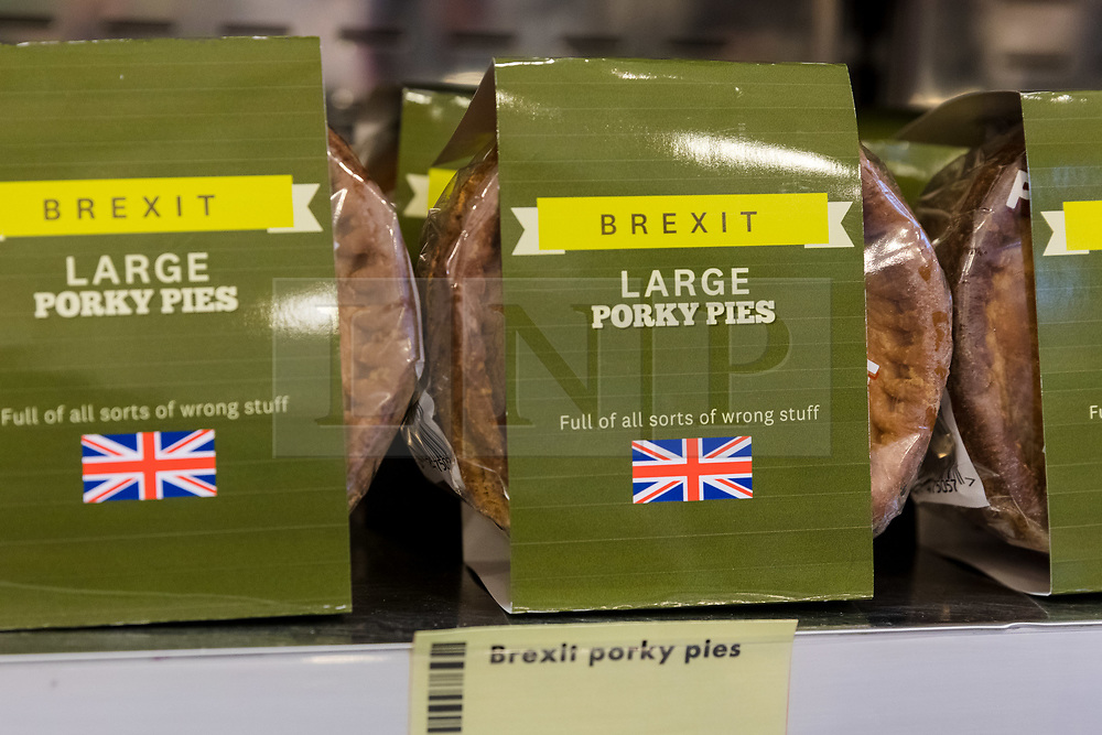 © Licensed to London News Pictures. 23/11/2018. London, UK.  'Brexit Large Porky Pies' pork pies on a shelf inside the People's Vote campaign stunt pop-up shop in Peckham High Street on Black Friday to show that the government's Brexit deal is a bad deal and the shop is stocked with household products, such as 'chlorinated' chicken to illustrate the bad deal. Photo credit: Vickie Flores/LNP