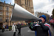 Anti Brexit pro Europe demonstration in Westminster on 27th March 2019 in London, England, United Kingdom. With the date of the UK leaving the European Union extended, the pro EU protest continues as MPs from all sides try to gain control of the process, as they debate the various options in the commons. Brexit protester Steve Bray with his giant megaphone.