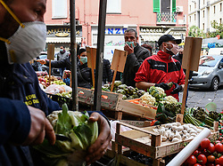 People wearing protective masks and gloves, in a market in Naples city, Italy on March 14, 2020, after a government decree declaring all of Italy a protected area to combat covid-19 coronavirus infection. Photo by Salvatore Laporta/IPA/ABACAPRESS.COM
