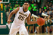 WACO, TX - DECEMBER 17: Al Freeman #25 of the Baylor Bears passes the ball against the New Mexico State Aggies on December 17, 2014 at the Ferrell Center in Waco, Texas.  (Photo by Cooper Neill/Getty Images) *** Local Caption *** Al Freeman