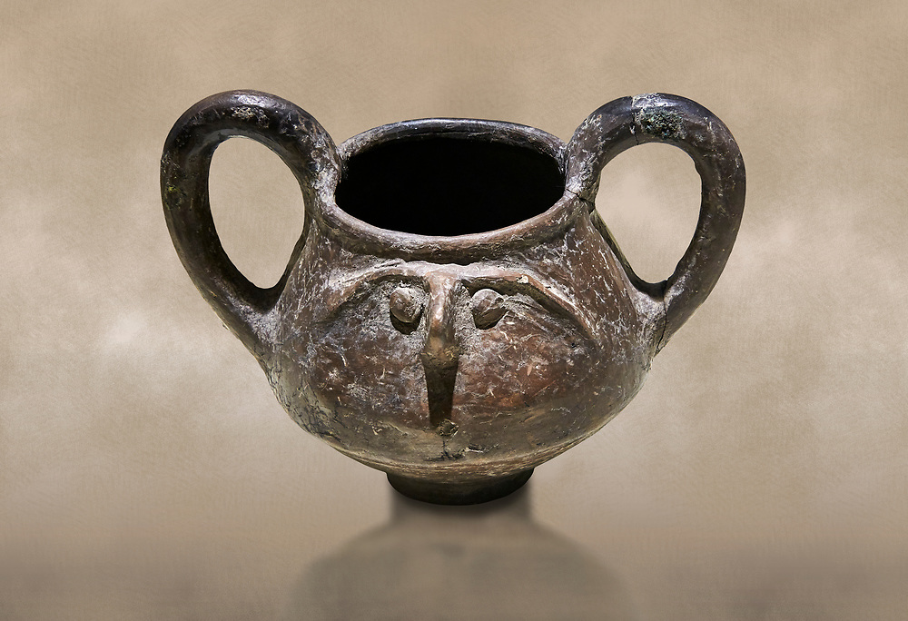 Hittite terra cotta double handled jug with a relief human face- 17th - 16th century BC - Hattusa ( Bogazkoy ) - Museum of Anatolian Civilisations, Ankara, Turkey .<br /> <br /> If you prefer to buy from our ALAMY STOCK LIBRARY page at https://www.alamy.com/portfolio/paul-williams-funkystock/hittite-art-antiquities.html  - Type Hattusa into the LOWER SEARCH WITHIN GALLERY box. Refine search by adding background colour, place, museum etc<br /> <br /> Visit our HITTITE PHOTO COLLECTIONS for more photos to download or buy as wall art prints https://funkystock.photoshelter.com/gallery-collection/The-Hittites-Art-Artefacts-Antiquities-Historic-Sites-Pictures-Images-of/C0000NUBSMhSc3Oo