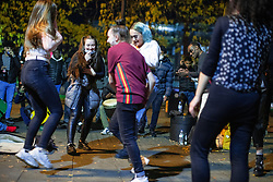 © Licensed to London News Pictures. 10/10/2020. Manchester, UK. Groups of people play music and dance in Piccadilly Gardens . People out in pubs, bars and restaurants in Manchester City Centre ahead of the currently imposed daily 10pm curfew . Millions of people across the north of England are waiting to learn if the British Government will impose a regional lockdown on Monday (12th October 2020), as Coronovirus infection rates continue to rise rapidly . Photo credit: Joel Goodman/LNP