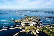 Nederland, Zeeland, Gemeente Schouwen-Duiveland, 01-04-2016; Philipsdam en Krammersluizen met in de achtergrond de Grevelingendam en grevelingenmeer. De twee dammen vormen samen met de sluizen een compartimenteringswerk waardoor het zoete water van Volkerak (rechts) en het zoute water van het Krammer gescheiden blijft. In de voorgrond de bedieningsgebouwen voor het zoet-zoutscheidingssysteem van de sluizen, de doorlaatwerken.<br /> Het geheel maakt deel uit maken van de Deltawerken.<br /> Philipsdam with Krammersluizen, part of the Delta Works. The locks form a division between sweet and salt water.<br /> <br /> <br /> luchtfoto (toeslag op standard tarieven);<br /> aerial photo (additional fee required);<br /> copyright foto/photo Siebe Swart