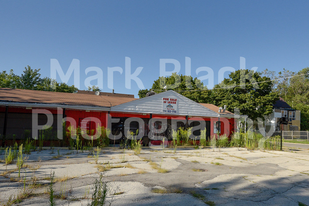 Boarded up business along 51st Street on Chicago's westside on Wednesday, Aug. 19, 2020.  Photo by Mark Black