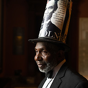 COLUMBIA, SC - August 6: Alvin Portee Jr., a delegate for the South Carolina GOP, poses for a portrait inside the main lobby of the South Carolina state house in his hometown of Columbia,  SC on August 6, 2020.  Portee is dressed in a suit, bow tie and top hat adorned with pictures of Abraham Lincoln, his favorite president.  The outfit is similar to what he would have brought to the 2020 Republican National Convention this year if it hadn't been cancelled due to COVID-19.   (Photo by Logan Cyrus for The Washington Post)