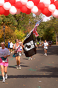 Twin Cities marathon runner age 42 carrying Pow-MIA  flag.  St Paul Minnesota USA