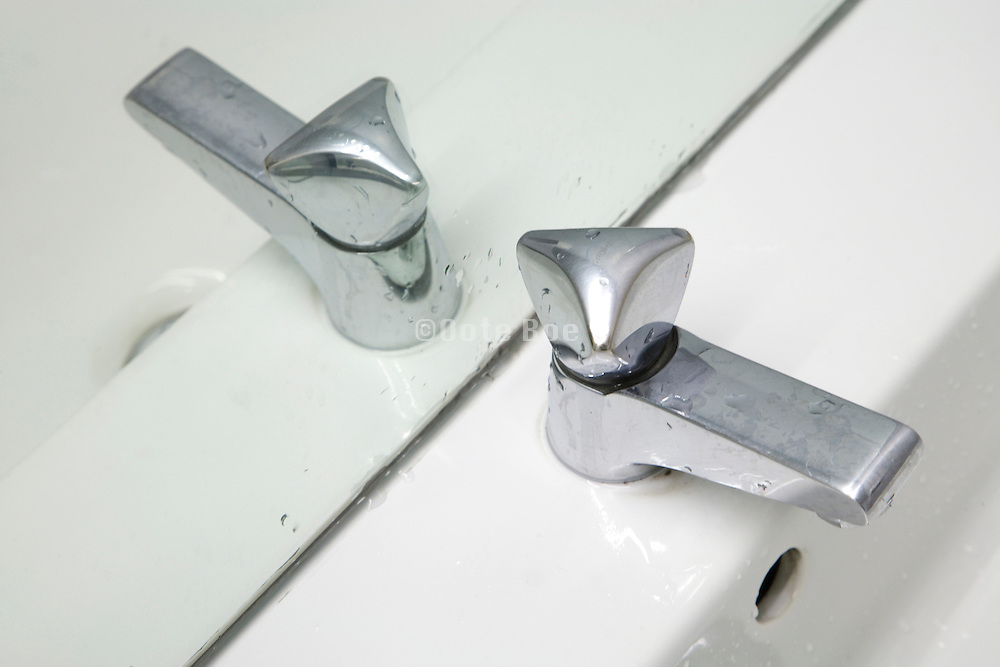 close up of water tap in a public bathroom