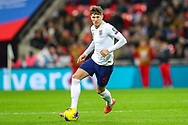 England defender John Stones on the ball during the UEFA European 2020 Qualifier match between England and Montenegro at Wembley Stadium, London, England on 14 November 2019.