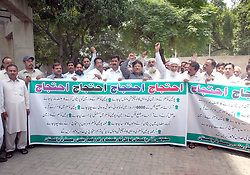 June 14, 2017 - Pakistan - GUJRANWALA, PAKISTAN, JUN 14: Members of All Pakistan Local Government Workers .Federation are holding protest demonstration for acceptance of their demands, in Gujranwala on .Wednesday, June 14, 2017. (Credit Image: © PPI via ZUMA Wire)