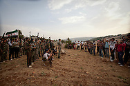 Soldiers from the Free Syrian Army (FSA) prepare to make a public defection video, stating that they have formed a new battalion with the FSA after defecting from the Regime's military. Idlib province in Syria's northwest is one of the few areas in Syria which is currently under FSA control, although this control is patchy and ever shifting. Rural Idlib, Syria. 16/06/2012