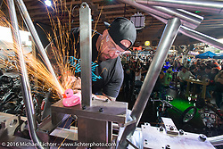 Will Ramsey welds a frame for a Cycle Source Grease & Gears demo at the Iron Horse Saloon during the annual Sturgis Black Hills Motorcycle Rally.  SD, USA.  August 8, 2016.  Photography ©2016 Michael Lichter.
