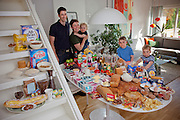 Ottersland Dahl Family. Gunhild Valle Ottersland, 45, her husband Tor Erik Dahn, 39, and their three children, Olav, 6 Hakon, 3, and Sverre, 1.5 of Gjettum, Norway, with their typical week's worth of food in June. Food expenditure for one week: 2211.97 Norwegian Kroner; $379.41 USD. Model-Released.
