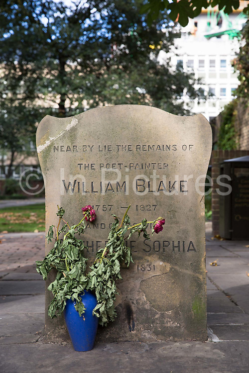 William Blakes gravestone in Bunhill Fields Burial Ground Cemetery on 10th October 2015 in London, United Kingdom. The former burial ground in the London Borough of Islington is now managed as a public garden by the City of London Corporation. It is about 1.6 hectares in extent and is the final resting place of William Blake, Daniel Defoe, John Bunyan and Susannah Wesley among others.