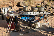 """Arizona Raft Adventures (AZRA) portable kitchen for cooking and dishwashing. Rafting through Marble Canyon on day 2 of 16 days boating 226 miles down the Colorado River in Grand Canyon National Park, Arizona, USA. Marble Canyon runs from Lees Ferry at River Mile 0 to the confluence with the Little Colorado River at Mile 62, which marks the beginning of the Grand Canyon. Although John Wesley Powell knew that no marble was found here when he named Marble Canyon, he thought the polished limestone looked like marble. In his words, """"The limestone of the canyon is often polished, and makes a beautiful marble. Sometimes the rocks are of many colors – white, gray, pink, and purple, with saffron tints."""""""