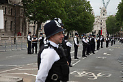 Police sterilise Whitehall, closing it down due to protests against the state visit of US President Donald Trump on 4th June 2019 in London, United Kingdom. Organisers Together Against Trump which is a collaboration between the Stop Trump Coalition and Stand Up To Trump, have organised a carnival of resistance, a national demonstration to protest against President Trump's policies and politics during his official UK visit.