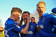 AFC Wimbledon attacker Shane McLoughlin (19) celebrating after scoring goal with AFC Wimbledon midfielder Callum Reilly (33) and AFC Wimbledon midfielder Mitchell (Mitch) Pinnock (11) during the EFL Sky Bet League 1 match between AFC Wimbledon and Fleetwood Town at the Cherry Red Records Stadium, Kingston, England on 8 February 2020.