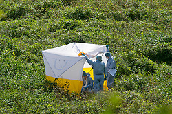 © Licensed to London News Pictures 27/09/2021.<br /> Biggin Hill, UK, Forensic officers at the scene. A large police cordon is in place around woodland and farmland in Biggin Hill, South East London. Unconfirmed local reports suggest a body has been discovered in a field. A police forensic tent has been in place overnight with forensic officers arriving on scene this morning. Photo credit:Grant Falvey/LNP