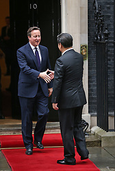 © Licensed to London News Pictures. 21/10/2015. London, UK.  Prime Minister David Cameron (L) welcomes Chinese President Xi Jinping to Downing Street. Photo credit: Peter Macdiarmid/LNP