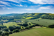 Aerial drone view of the South Downs landscape in West Sussex, England, UK. With green rural scene of farmland and hillside.