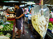 20 JUNE 2018 - BANGKOK, THAILAND: Mushrooms in a plastic bag at Makkasan Market, a small local market in central Bangkok. Officials in Thailand are wrestling with Thais use of plastic bags. The issue became a public one in early June when a whale in Thai waters died after ingesting 18 pounds of plastic. In a recent report, Ocean Conservancy claimed that Thailand, China, Indonesia, the Philippines, and Vietnam were responsible for as much as 60 percent of the plastic waste in the world's oceans.      PHOTO BY JACK KURTZ