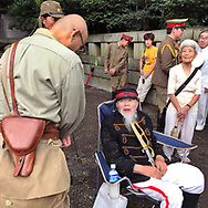 August 15, 2017, Tokyo, Japan: Part of the spectacle at Yasukuni Shrine on anniversary of the end of World War II always includes patriotic fanatics dressing up in military costumes. But for all the other tens of thousands who came out in the rain, they came to pay their respects for Japan's war dead at Yasukuni, the national Shinto shrine where nearly 2.5 million war dead from the past 150 years are enshrined. Visits to Yasukuni by top Japanese politicians continue to outrage China and South Korea because it honors 14 World War II class A war criminals who are also enshrined there. Even so, dozens of Japanese lawmakers visited Yasukuni Shrine today, while PM Shinzo Abe sent a ritual offering via his emissary. Photo by Torin Boyd.
