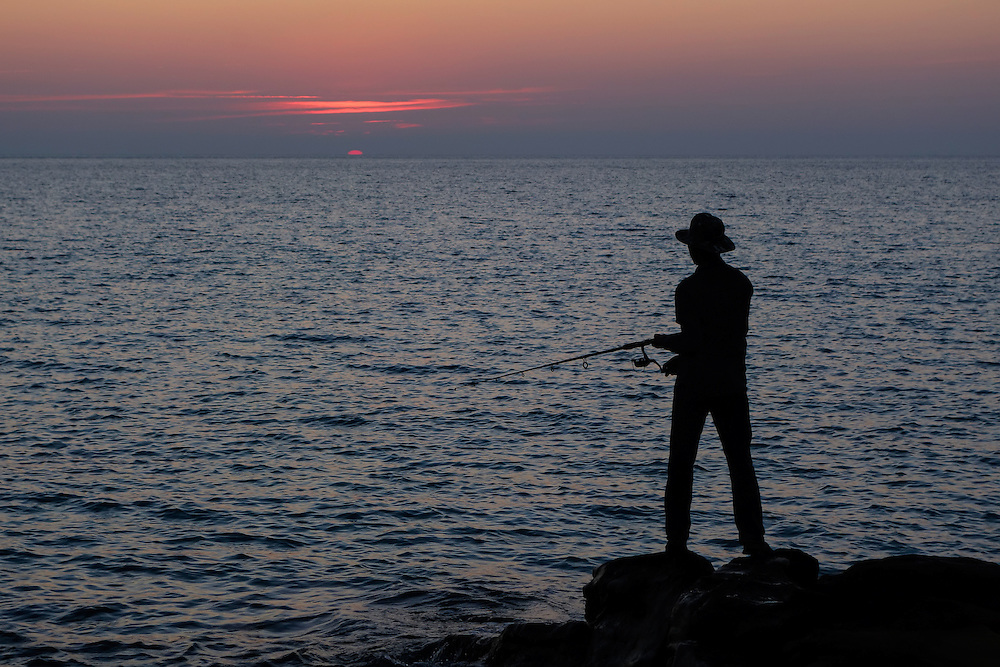 Fisherman on the coast of the Gulf of Thailand at sunset, Koh Kood, Thailand