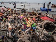 Collected idols of Ganesha litter the beach after the traditional Ganapati Visarjan in Mumbai during the annual 10-day festival celebrtaing the Elephant God on September 13, 2019. Idols such as this one will be immersed into the sea on the tenth day of the festival. Around 150,000 idols are set up around the city in community centers and people's homes for worship. Throughout the festival nearly a million people a day will visit arguably the most popular pandal, the Lalbaughcha Raja in the heart of the city. They will offer Ganesha his favorite modak sweets, a type of sweet rice dumpling, and donations in the form of cash, gold and silver.