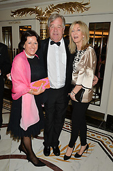 Left to right, CAROL PRITCHARD-GORDON, SIR MICHAEL STOUTE and LAURA WEINSTOCK  at the 24th Cartier Racing Awards held at The Dorchester, Park Lane, London on 11th November 2014.
