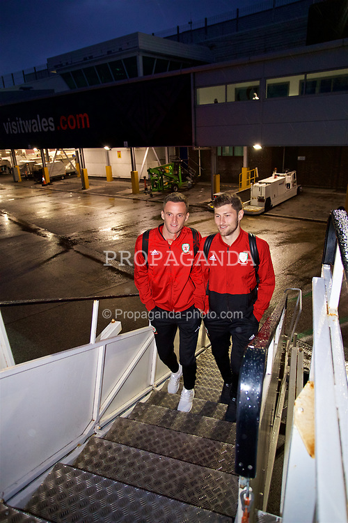 CARDIFF, WALES - Saturday, September 8, 2018: Wales' Andy King (left) and Ben Davies (right) board the team plane as the squad fly to Aarhus from Cardiff Airport ahead of the UEFA Nations League Group Stage League B Group 4 match against Denmark. (Pic by David Rawcliffe/Propaganda)