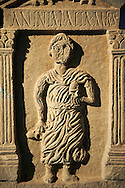 Detail of a second century Roman funerary stele dedicated to Anninia Laeta from the cemetery of Thuburbo Majus a city of the Roman province of Africa Proconsularis, in present day Tunisia. The Bardo National Museum , Tunis, Tunisia.