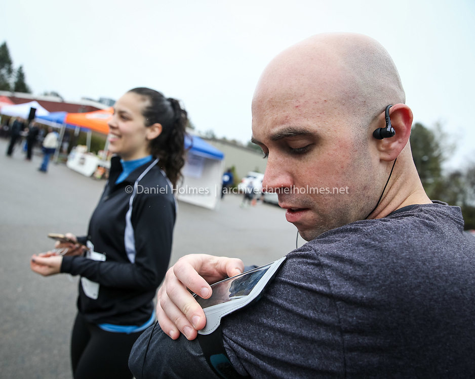 (5/7/16, FRANKLIN, MA) Vin Guarino and <br /> Michele Lemmo, of Franklin, get prepared for the race during the Elks Care Elks Share 5K Road Race and Walk at the Franklin Elks Lodge on Saturday. Daily News and Wicked Local Photo/Dan Holmes