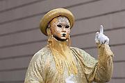 Street performer in Venetian mask, Rome, Italy